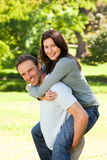 Man giving wife a piggyback Stock Image