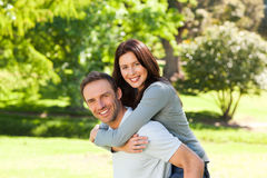 Man giving wife a piggyback Stock Images