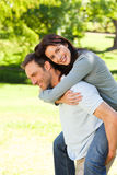 Man giving wife a piggyback Royalty Free Stock Photo