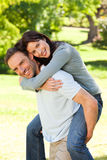 Man giving wife a piggyback Royalty Free Stock Images