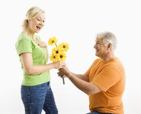 Man giving woman bouquet. Stock Photography