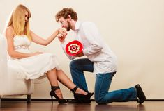 Man giving woman candy bunch flowers. Happy couple stock image
