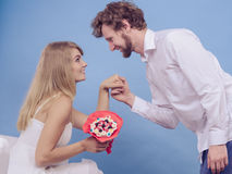 Man giving woman candy bunch flowers. Happy couple Royalty Free Stock Images