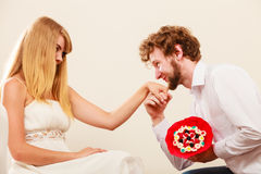 Man giving woman candy bunch flowers. Happy couple Royalty Free Stock Photo