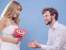 Man giving woman candy bunch flowers. Happy couple Stock Photos
