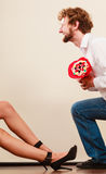 Man giving woman candy bunch flowers. Happy couple Royalty Free Stock Image