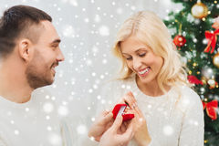 Man giving woman engagement ring for christmas Stock Photography