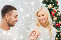 Man giving woman engagement ring for christmas Stock Images