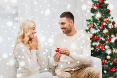Man giving woman engagement ring for christmas Royalty Free Stock Photography