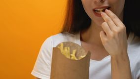Man giving woman french fries in carton box, american cuisine, food delivery. Stock footage stock footage