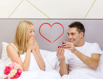 Man giving woman little red box and ring in it Royalty Free Stock Photos