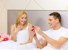 Man giving woman little red box and ring in it Stock Photography