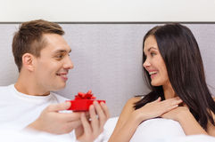Man giving woman little red gift box Royalty Free Stock Images