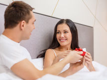 Man giving woman little red gift box Stock Image