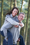 Man Giving Woman Piggyback On Country Walk Royalty Free Stock Photos