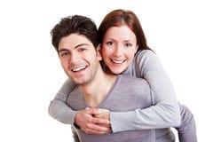 Man giving woman piggyback ride Stock Photos