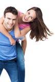 Man giving woman piggyback ride Royalty Free Stock Photo