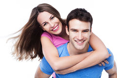 Man giving woman piggyback ride Stock Image