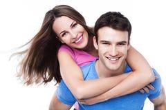 Man giving woman piggyback ride Stock Image
