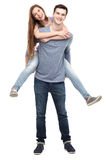 Man giving woman piggyback ride Royalty Free Stock Images