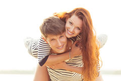Man giving woman piggyback Stock Photos