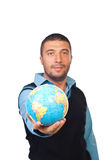 Man giving world globe Stock Images