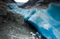 Man and glacier. Man under the Briksdalsbreen glacier Royalty Free Stock Images