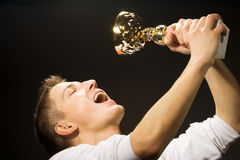 Man is glad. The won cup royalty free stock photo