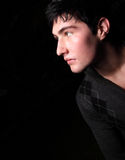Man glancing away. Young male looking away from the camera Royalty Free Stock Photo