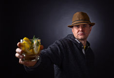 Man with glass of alcoholic drink Stock Photography