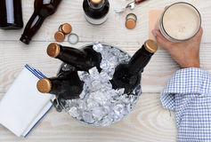 Man With Glass of Beer and Bucket Stock Images