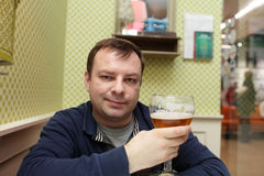 Man with glass of beer Stock Photography