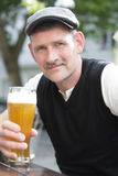 Man with a glass of beer Royalty Free Stock Image
