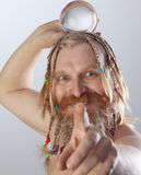 A man and a glass bowl Stock Image