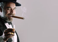 Man with glass and cigar Royalty Free Stock Photography