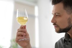 Man with glass of delicious wine. Indoors Stock Image