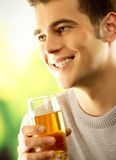Man with glass of fruit juice Stock Images