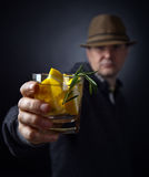 Man with a glass of lemon drink Stock Image