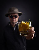 Man with a glass of lemon drink Royalty Free Stock Images