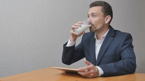 Man with a glass of milk online stock video footage