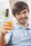 Man with glass orange juice Stock Photo