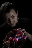 Man and glass sphere Stock Images