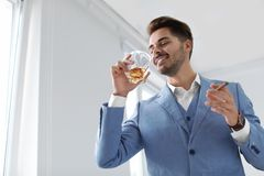 Man with glass of whiskey and cigar royalty free stock photos