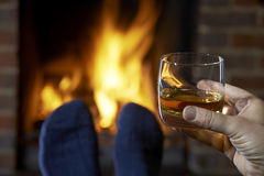 Man With Glass Of Whisky Relaxing By Fire Stock Photos