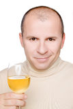 Man with a glass of white wine Royalty Free Stock Images