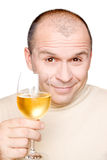 Man with glass of white wine Royalty Free Stock Photos