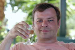 Man with glass of white wine Royalty Free Stock Photo