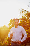Man with a glass of white wine Royalty Free Stock Photography