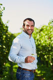 Man with a glass of white wine Stock Photos