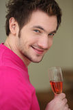 Man with glass of wine Stock Image